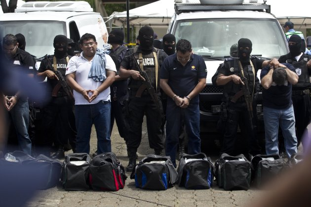 Nicaragua National Police present 18 foreigners believed to be Mexican nationals who posed as Televisa journalists, in Managua, Nicaragua, Friday, Aug. 24, 2012. Police Commissioner Aminta Granera said the men posed as Televisa journalists to cover the trial of Nicaraguan businessman Henry Fariñas, survivor of an attack that killed the singer Facundo Cabral last year. The Mexican ambassador to Nicaragua confirmed that the Mexican news channel has no correspondents in Nicaragua. It is unclear why the men were posing as journalists. (AP Photo/Esteban Felix)