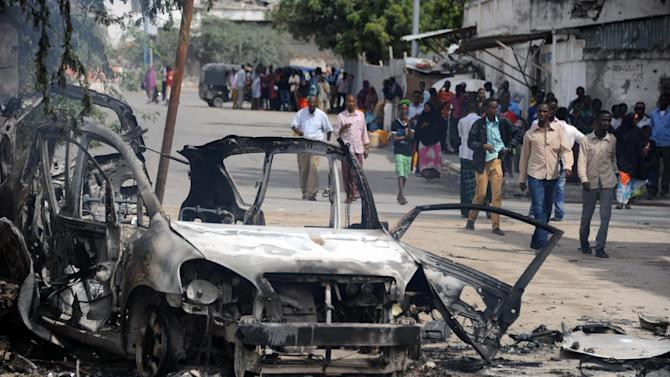 A burned out car marks the site of a major car bomb by Shebab insurgents in Mogadishu, on August 31, 2014