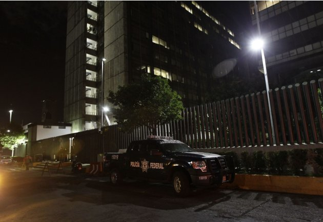 A Federal Police vehicle is parked outside the building after an evacuation at Pemex tower in Mexico City