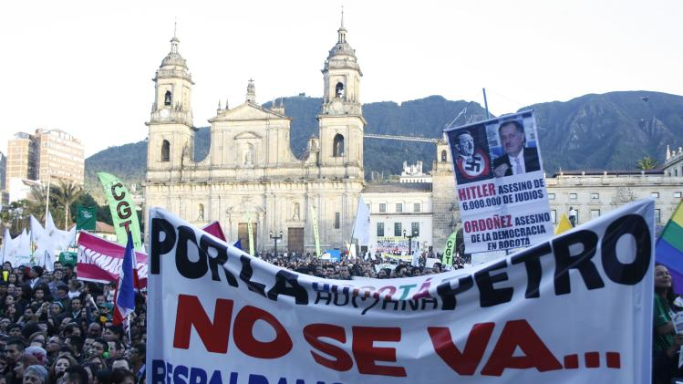 People protest against a decision by Colombia's Inspector General Ordonez to remove Bogota mayor Petro from his post at Bogota's Bolivar Square