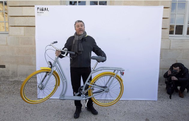 French designer Philippe Starck presents his &quot;Pibal&quot; public bicycle during a photocall at the Bordeaux city hall