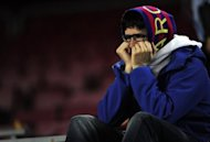 A Barcelona supporter holds his hands to his mouth after losing to Chelsea after the UEFA Champions League semi-final match at the Cam Nou stadium in Barcelona. Roberto Di Matteo hailed the phenomenal spirit of his players after Chelsea completed the latest in a line of stunning fightbacks to upset Barcelona and advance to the Champions League final