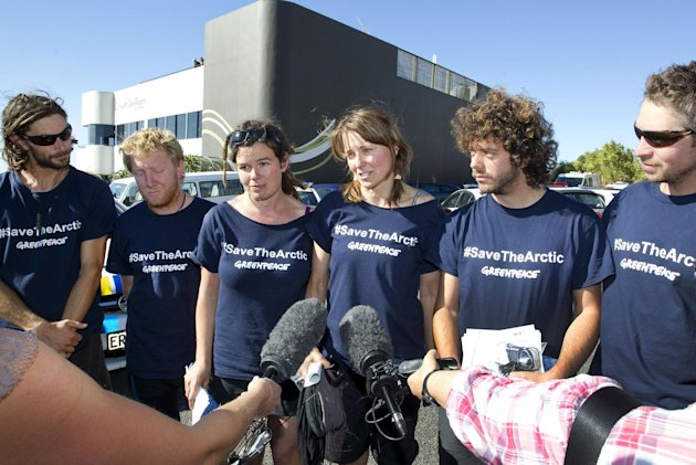 In this photo provided by Greenpeace, actress Lucy Lawless, fourth from left, and five Greenpeace activists, from left, Mike Buchanan, Raoni Hammer, Vivienne Hadlow, Shai Nades and Shayne Comino, spea