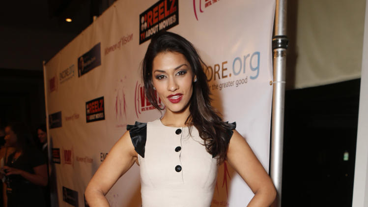 Janina Gavankar attends A New Way of Life Reentry Project 14th Annual Fundraising Gala on Sunday December 9, 2012 in Los Angeles, California.  (Photo by Todd Williamson/Invision/AP Images)