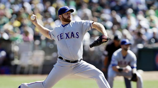 FILE - This Oct. 3, 2012 file photo shows Texas Rangers starting pitcher Ryan Dempster throwing against the Oakland Athletics during the first inning of a baseball game in Oakland, Calif. Two people familiar with the negotiations say the Boston Red Sox have agreed to a $26.5 million, two-year contract with Dempster. The people spoke on condition of anonymity Thursday, Dec. 13, 2012,  because the agreement is pending a physical. (AP Photo/Marcio Jose Sanchez, File)