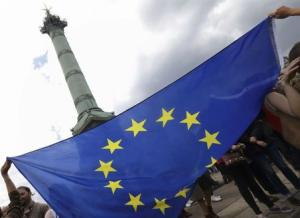 French students hold the European flag near the Bastille as they participate in a demonstration to protest the results by France's far-right National Front political party in the European election in Paris