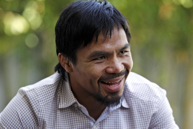 Boxer and politician Manny Pacquiao speaks about his views on same-sex marriage at his home in Los Angeles, Wednesday, May 16, 2012. Pacquiao was quoted in a recent interview as opposing President Bar