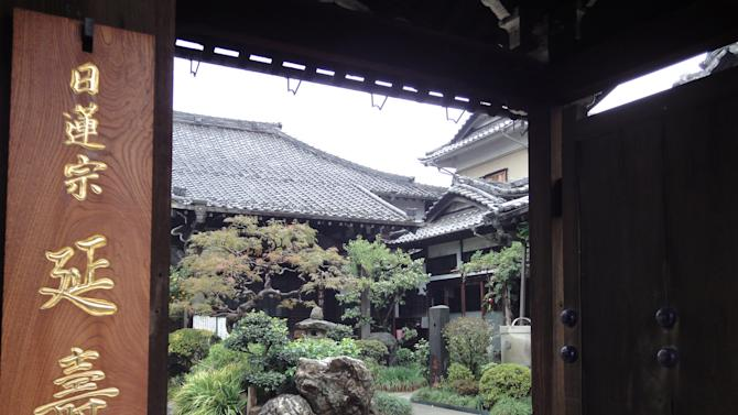 This Oct. 29, 2013 photo shows a temple in the Yanaka neighborhood of Tokyo. The Yanesen area (Yanaka, Sendagi, and Nezu) of the city has an unusually large number of temples, with 73 in Yanaka alone. (AP Photo/Linda Lombardi)