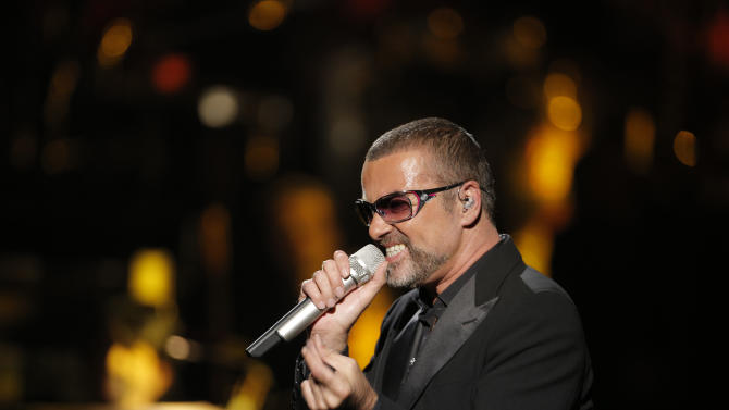 "FILE - In this Sept. 9, 2012 file photo, British singer George Michael performs at a concert to raise money for AIDS charity Sidaction, during the Symphonica tour at Palais Garnier Opera house in Paris, France. George Michael's publicist says the singer is being treated for minor injuries after he was a passenger in a car crash. A statement released Friday May 17, 2013 said he was in the accident on Thursday night and suffered ""superficial cuts and bruises."" (AP Photo/Francois Mori, File)"