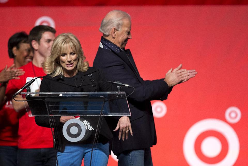 Vice President Joe Biden applauds as his wife Jill Biden introduce the members of the Biden family during the National Day of Service, part of the 57th presidential inauguration in Washington, Saturday, Jan. 19, 2013.   (AP Photo/Manuel Balce Ceneta)
