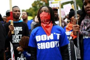 Demonstrators stand during a rally in St. Lou …