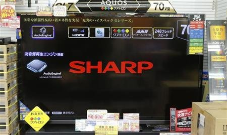 The logo of Sharp Corp is displayed on its Aquos television at an electronics store in Tokyo January 15, 2013. REUTERS/Toru Hanai