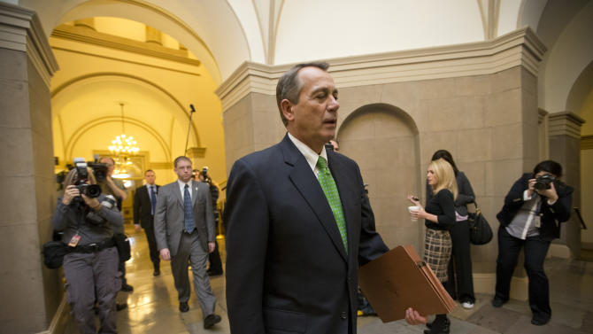 House Speaker John Boehner Ohio walks to his office on Capitol Hill in Washington, Tuesday, Jan. 1, 2013, as legislation to negate a fiscal cliff of across-the-board tax increases and sweeping spending cuts moves to the GOP-dominated House following a bipartisan, middle-of-the-night approval in the Senate. Boehner is expected to encounter opposition from conservatives within his own party.  (AP Photo/J. Scott Applewhite)