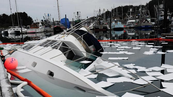This undated image provided by the U.S. Coast Guard shows the U.S. Fish and Wildlife Service research vessel Arlluk after it sank at the pier in St. Herman's harbor in Kodiak, Alaska, Friday Feb. 8, 2013. Coast Guard Marine Safety Detachment Kodiak personnel responded to the sinking and are assisting with pollution mitigation and salvage of the vessel. (AP Photo/U.S. Coast Guard, Petty Officer 3rd Class Jonathan Klingenberg)