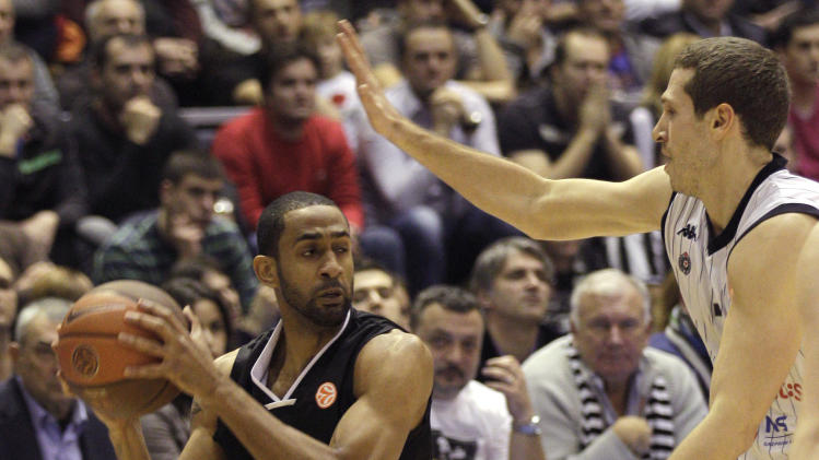 Drew Nicholas of EA7 Emporio Armani, left, drives to the basket as he is guarded by Dusan Kecman of Partizan Belgrade during their Group C Euroleague basketball match in Belgrade, Serbia, Thursday, Dec. 22, 2011. (AP Photo/Darko Vojinovic)