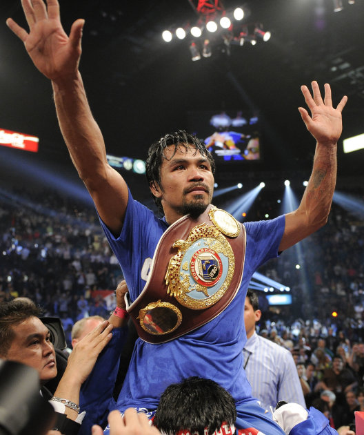 Manny Pacquiao celebrates after defeating Shane Mosley by unanimous decision during a WBO welterweight title bout, Saturday, May 7, 2011, in Las Vegas.  (AP Photo/Mark Terrill)