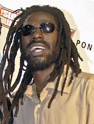 FILE - In this Oct. 13, 2003 file photo, Jamaican reggae star Buju Banton poses at the Source Hip-Hop Music Awards in Miami. A federal judge has denied reggae singer Buju Banton&#39;s request for a new trial, saying there&#39;s no need because of a previous appeals court ruling. A Florida jury found Grammy-winning reggae singer Buju Banton guilty on cocaine conspiracy on Feb. 22, 2011 after deliberating for 11 hours over two days. Banton is serving a 10-year prison sentence. (AP Photo/Yesikka Vivancos, File)