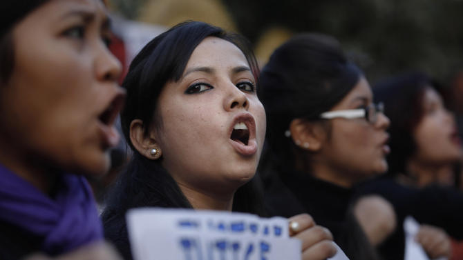 Students shout slogans during a protest against a leader of the ruling Congress party, who was arrested on accusations he raped a woman in a village in the early hours of the morning, in Gauhati, India, Thursday, Jan. 3, 2013. Footage on Indian television showed the extraordinary scene of local women surrounding Bikram Singh Brahma, ripping off his shirt and repeatedly slapping him across the face. A Dec. 16 gang rape on a woman, who later died of her injuries, has caused outrage across India, sparking protests and demands for tough new rape laws, better police protection for women and a sustained campaign to change society's views about women. (AP Photo/Anupam Nath)