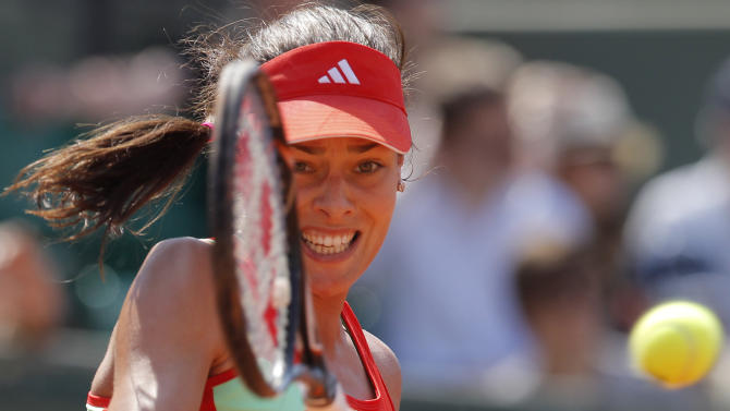 Serbia's Ana Ivanovic returns the ball to Spain's Lara Arruabarrena-Vecino during their first round match in the French Open tennis tournament at the Roland Garros stadium in Paris, Sunday, May, 27, 2012.  (AP Photo/Michel Euler)