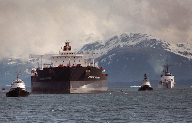 FILE - In this June 23, 1989 file photo, the Exxon Valdez is towed out of Prince William Sound in Alaska by a tug boat and a U.S. Coast Guard Cutter. India&#39;s Supreme Court on May 3, 2012 banned the Exxon Valdez from entering India, saying the ship involved in one of the worst U.S. oil spills will not be allowed in for dismantling until it has been decontaminated. The ship, now known as the &quot;Oriental Nicety,&quot; entered Indian waters last week and was headed for the western Indian state of Gujarat for dismantling, when the Supreme Court gave its order, environmental activist Gopal Krishna said Wednesday. (AP Photo/Al Grillo, File)