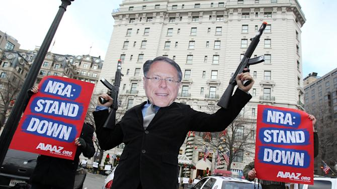 Members of the activist group Avaaz protest today's NRA press conference with a likeness of NRA CEO Wayne LaPierre Jr., calling on NRA affiliates like Days Inn and Super 8 to get