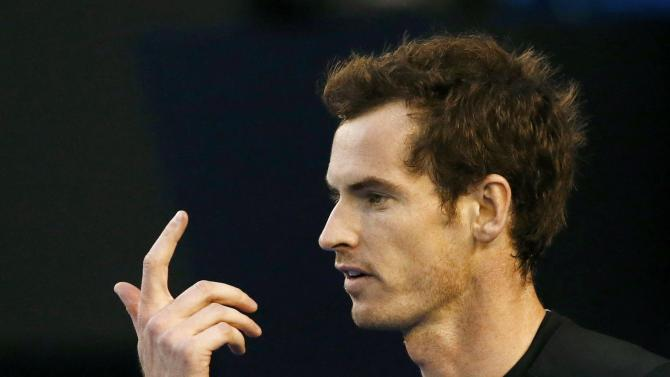 Andy Murray of Britain reacts after missing a return against Nick Kyrgios of Australia during their men's singles quarter-final match at the Australian Open 2015 tennis tournament in Melbourne