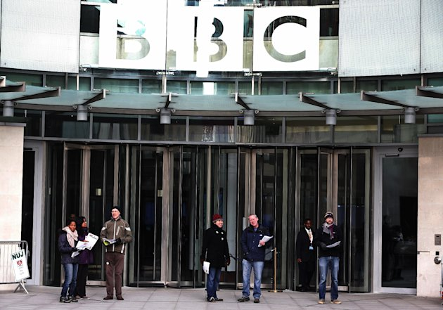 BBC journalists mount picket lines after launching a 24-hour strike in a row over jobs, outside the BBC Broadcasting House, in central London, Monday, Feb. 18, 2013. (AP Photo/Lefteris Pitarakis)