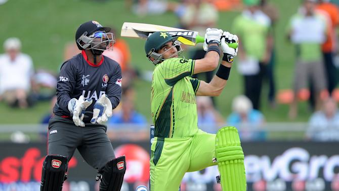 Pakistan's Misbah Ul Haq plays a shot as United Arab Emirates wicketkeeper Swapnil Patil  watches during their Cricket World Cup Pool B match in Napier, New Zealand, Wednesday, March 4, 2015. (AP Photo Ross Setford)