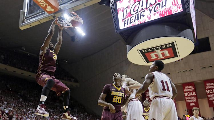 Minnesota's Trevor Mbakwe (32) dunks during the first half of an NCAA college basketball game against Indiana, Saturday, Jan. 12, 2013, in Bloomington, Ind. (AP Photo/Darron Cummings)