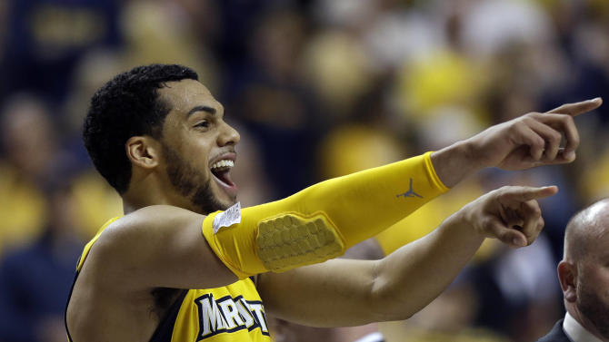 Marquette guard Trent Lockett (22) reacts after defeating Butler 74-72 in a third-round NCAA college basketball tournament game on Saturday, March 23, 2013, in Lexington, Ky. (AP Photo/John Bazemore)