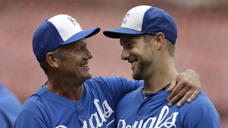 Kansas City Royals' George Brett, left, laughs with Royals' Alex Gordon during batting practice before a baseball game against the St. Louis Cardinals, Thursday, May 30, 2013, in St. Louis. The Royals announced on Thursday that Brett will be the club's interim hitting coach. (AP Photo/Jeff Roberson)