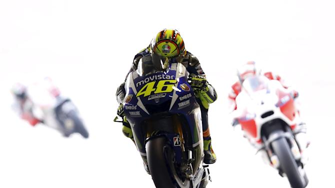 Yamaha MotoGP rider Valentino Rossi of Italy rides during a free practice session at the Twin Ring Motegi circuit ahead of Sunday's Japanese Grand Prix in Motegi, Japan