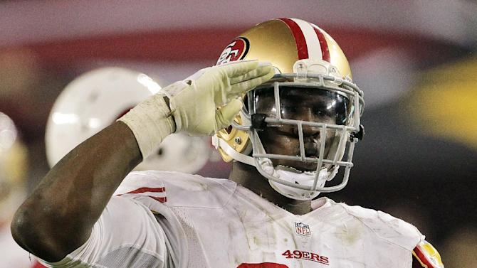 San Francisco 49ers outside linebacker Aldon Smith (99) salutes the fans after sacking Arizona Cardinals quarterback John Skelton during the second half of an NFL football game, Monday, Oct. 29, 2012, in Glendale, Ariz. (AP Photo/Matt York)