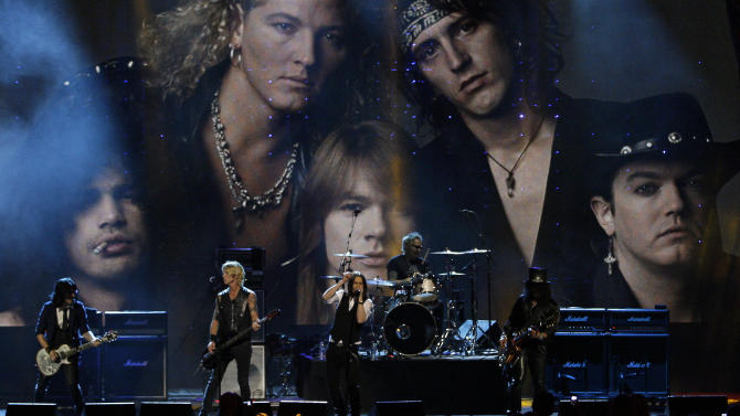 Guns N' Roses performs after into the Rock and Roll Hall of Fame Saturday, April 14, 2012, in Cleveland. (AP Photo/Tony Dejak)