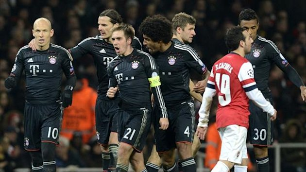Bayern Munich players celebrate against Arsenal at the Emirates (AFP)