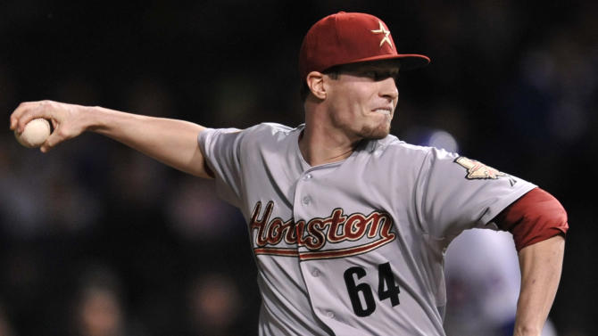 Houston Astros starter Lucas Harrell delivers a pitch in the first inning during a baseball game against the Chicago Cubs in Chicago, Monday, Oct. 1, 2012. (AP Photo/Paul Beaty)
