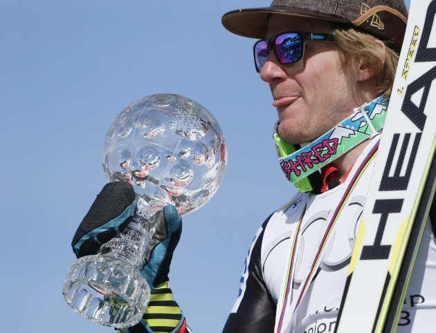 Ligety of the US shows the men's Giant-Slalom trophy following the season's last race at the Alpine Skiing World Cup finals in Lenzerheide