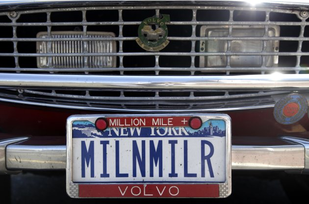"Irv Gordon's Volvo P1800 displays the license plate ""MILNMILR"" in Babylon, N.Y., Monday, July 2, 2012. Gordon's car already holds the world record for the highest recorded milage on a car and he is le"