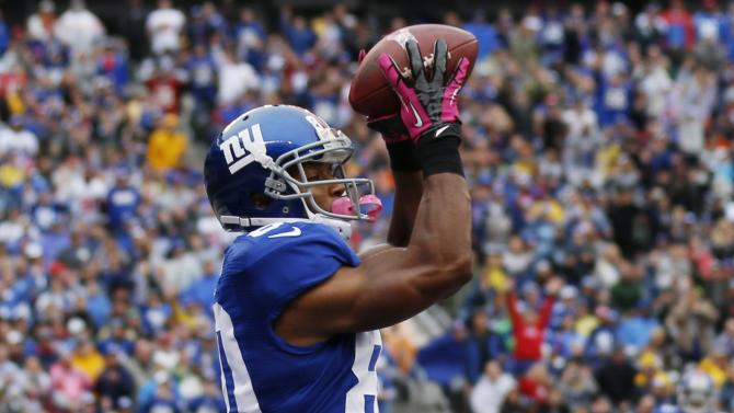 New York Giants wide receiver Victor Cruz (80) catches a pass for a touchdown during the first half of an NFL football game against the Cleveland Browns Sunday, Oct. 7, 2012, in East Rutherford, N.J. (AP Photo/Julio Cortez)