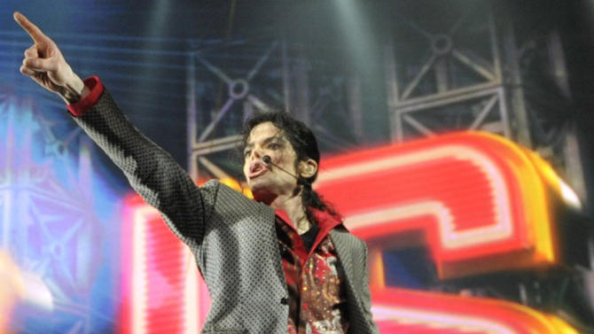 """** ALTERNATE CROP ** In this June 23, 2009 handout photo provided by AEG, pop star Michael Jackson rehearses at the Staples Center in Los Angeles. Jackson's longtime makeup artist and hair stylist, Karen Faye, told a Los Angeles jury on Friday, June 28, 2013, that the entertainer was more more engaged in his final two rehearsals, but she still had concerns that he was healthy enough to pull off the premiere of his """"This Is It"""" shows. (AP Photo/Kevin Mazur, AEG/Getty Images) ** MANDATORY CREDIT. NO SALES, ARCHIVE OUT **"""