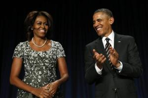U.S. President Obama applauds as he and the first lady attend the National Prayer Breakfast in Washington