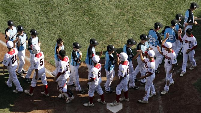 Tokyo, Japan and Goodlettsville, Tenn., players meet after the Little League World Series championship baseball game, Sunday, Aug. 26, 2012, in South Williamsport, Pa. Japan won 12-2 in five innings. (AP Photo/Matt Slocum)