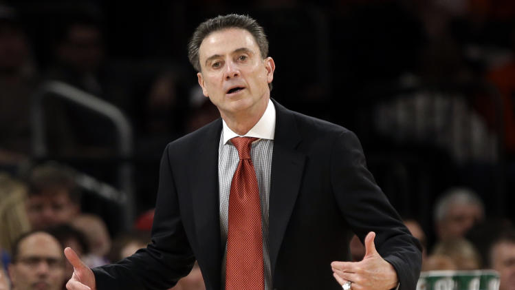 Louisville head coach Rick Pitino reacts during the first half of an NCAA college basketball championship game against the Syracuse at the Big East Conference tournament Saturday, March 16, 2013, in New York. (AP Photo/Frank Franklin II)