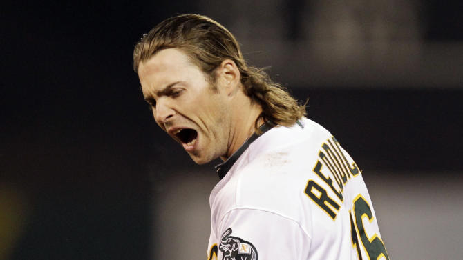 Oakland Athletics Josh Reddick reacts after flying out in the sixth inning of Game 4 of an American League division baseball series against the Detroit Tigers in Oakland, Calif., Wednesday, Oct. 10, 2012. (AP Photo/Ben Margot)