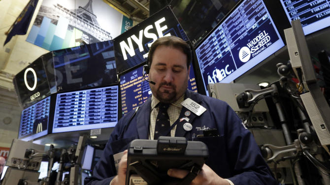 Trader Michael Mozian works on the floor of the New York Stock Exchange Wednesday, Jan. 30, 2013.  Stocks are falling after the government revealed that economic growth shrank in the final quarter of 2012, the first time that's happened in more than three years. (AP Photo/Richard Drew)