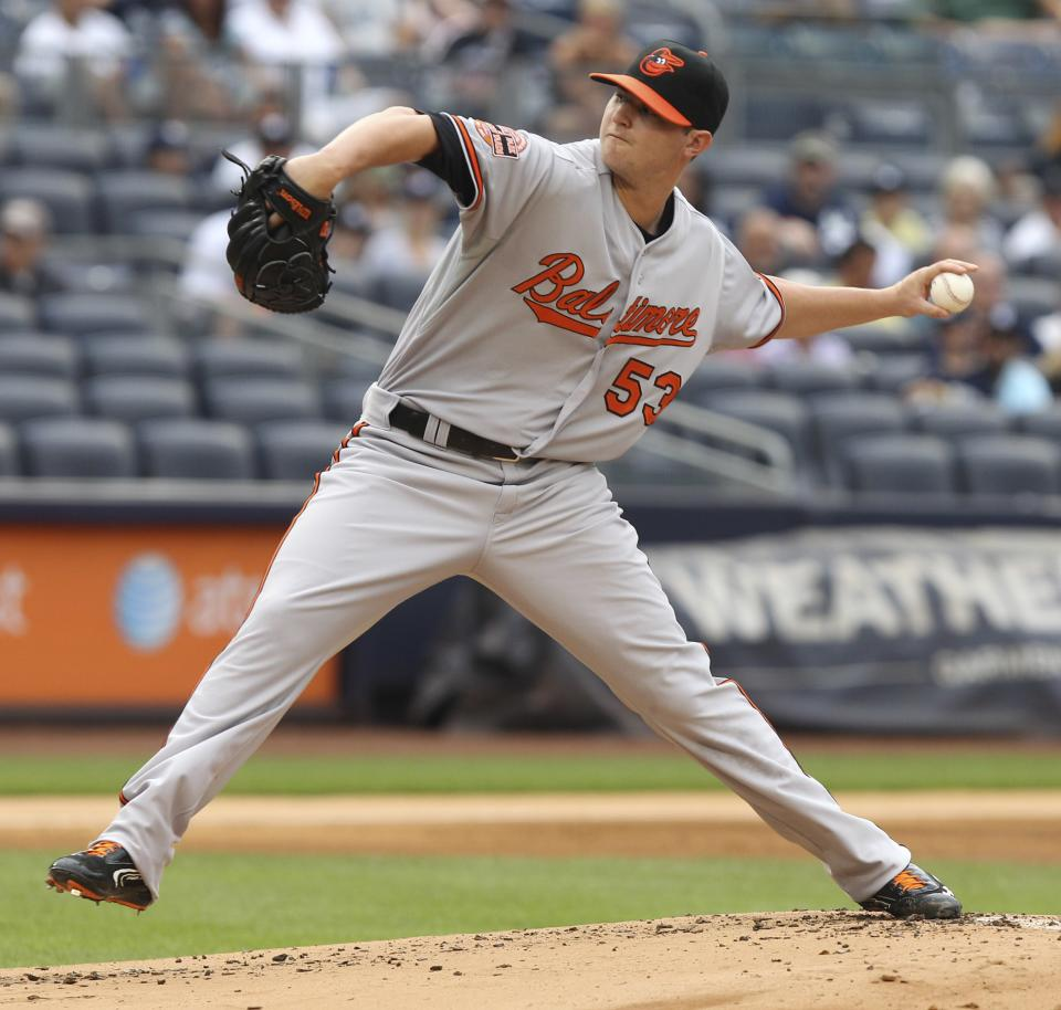 Baltimore Orioles' Zach Britton pitches during the first inning of the baseball game against the New York Yankees, Wednesday, Aug. 1, 2012, at Yankee Stadium in New York. (AP Photo/Seth Wenig)