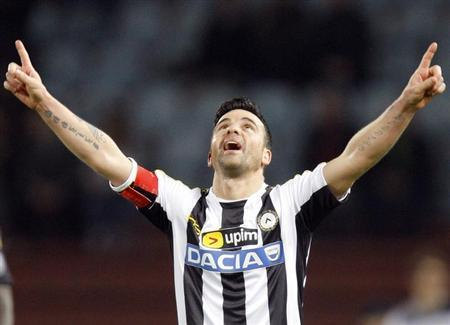 Udinese's Antonio Di Natale celebrates after scoring against AC Milan during their Italian Serie A soccer match at Friuli stadium in Udine March 8, 2014. REUTERS/Alessandro Garofalo