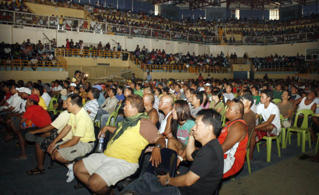 People Watch The Live Telecast Of The WBO Welterweight Title Bout Between Philippine Boxing Icon Manny Pacquiao And  AFP/Getty Images