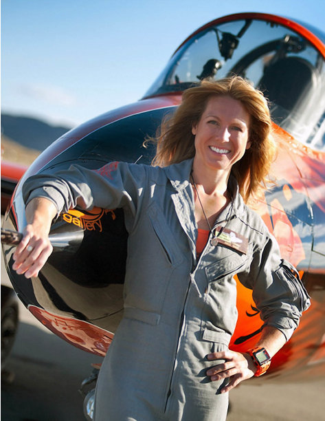 "This photo provided by the National Championship Air Races shows Heather Penney in front of the race jet ""Ragu Grace"", in Reno, Nev.. Fighter pilot Heather ""Lucky"" Penney didn't have time to be scared. There was a hijacked commercial airliner headed to Washington, D.C., and she was ordered to stop it. On Sept. 11, 2001, Penney and her commanding officer were ordered to stop United Airlines Flight 93 from hitting a target in the nation's capital. But they didn't have any missiles or even ammunition. So Col. Marc Sasseville decided they would use their own planes to bring it down.  (AP Photo/National Championship Air Races, Tyson Rininger)"