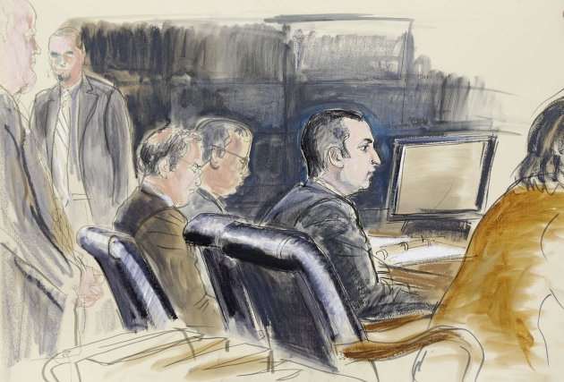 FILE- In this Feb. 25, 2013, courtroom sketch, former New York City Police Officer Gilberto Valle, second right, is seated at federal court in New York. An FBI agent says a New York police officer acc
